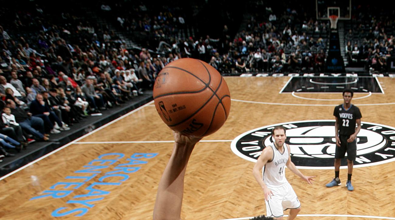BROOKLYN, NY - DECEMBER 20: Karl-Anthony Towns #32 of the Minnesota Timberwolves goes for the dunk during the game against the Brooklyn Nets on December 20, 2015 at Barclays Center in Brooklyn, New York. (Photo by Nathaniel S. Butler/NBAE via Getty Images