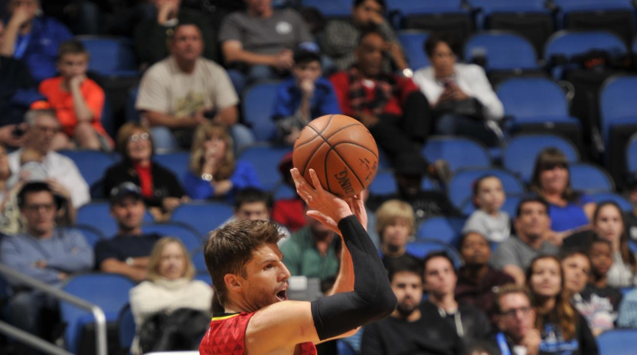 ORLANDO, FL - DECEMBER 20: Kyle Korver #26 of the Atlanta Hawks shoots against the Orlando Magic during the game on December 20, 2015 at Amway Center in Orlando, Florida. (Photo by Fernando Medina/NBAE via Getty Images)