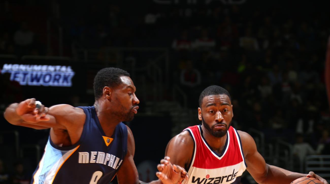 WASHINGTON, DC - DECEMBER 23: John Wall #2 of the Washington Wizards drives to the basket against Tony Allen #9 of the Memphis Grizzlies during the game on December 23, 2015 at Verizon Center in Washington, District of Columbia. (Photo by Ned Dishman/NBAE