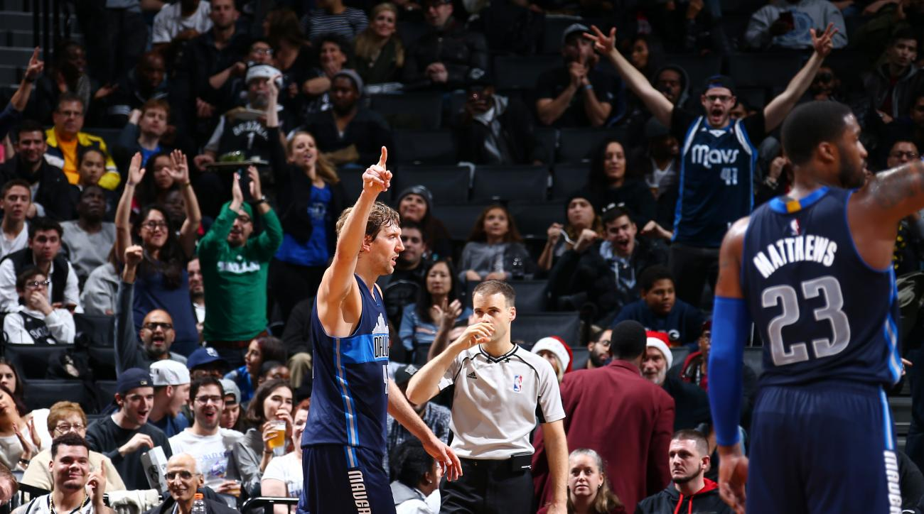 BROOKLYN, NY - DECEMBER 23: Dirk Nowitzki #41 of the Dallas Mavericks celebrates after he moves into sixth place of the all time NBA scoring list during the game against the Brooklyn Nets on December 23, 2015 at Barclays Center in Brooklyn, New York. (Pho