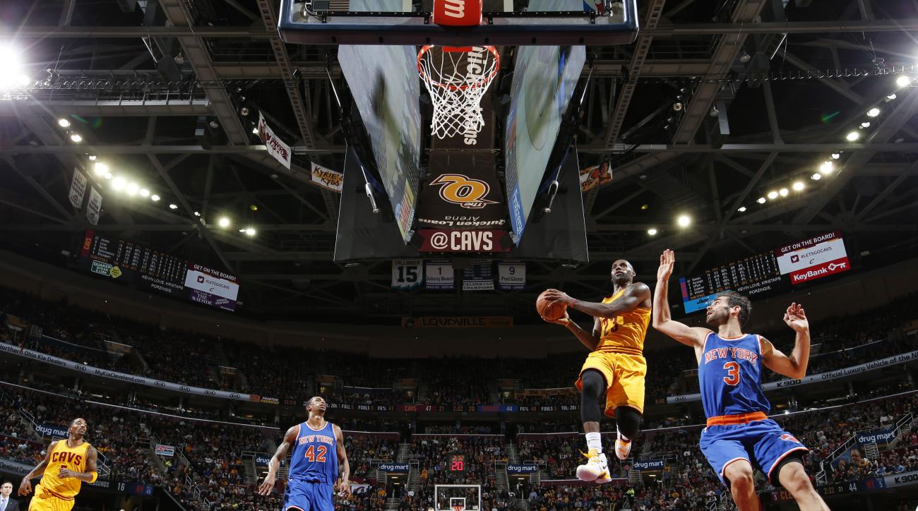 CLEVELAND, OH - DECEMBER 23: LeBron James #23 of the Cleveland Cavaliers shoots the ball against the New York Knicks  on December 23, 2015 at Quicken Loans Arena in Cleveland, Ohio. (Photo by Gregory Shamus/NBAE via Getty Images)