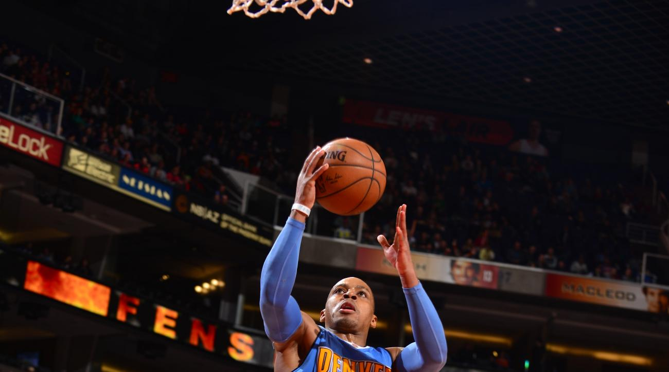 PHOENIX, AZ - DECEMBER 23:  Randy Foye #4 of the Denver Nuggets shoots the ball against the Phoenix Suns on December 23, 2015 at Talking Stick Resort Arena in Phoenix, Arizona. (Photo by Barry Gossage/NBAE via Getty Images)