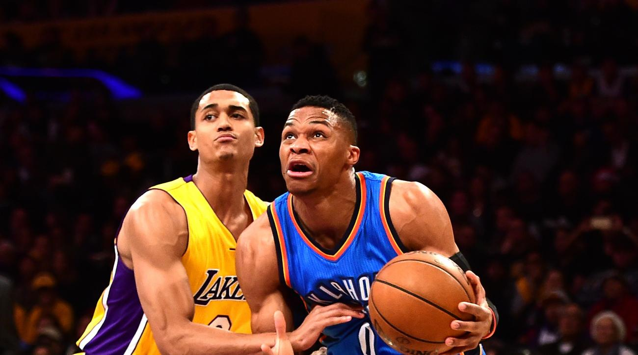 LOS ANGELES, CA - DECEMBER 23:  Russell Westbrook #0 of the Oklahoma City Thunder drives past Jordan Clarkson #6 of the Los Angeles Lakers during the first half at Staples Center on December 23, 2015 in Los Angeles, California.  (Photo by Harry How/Getty