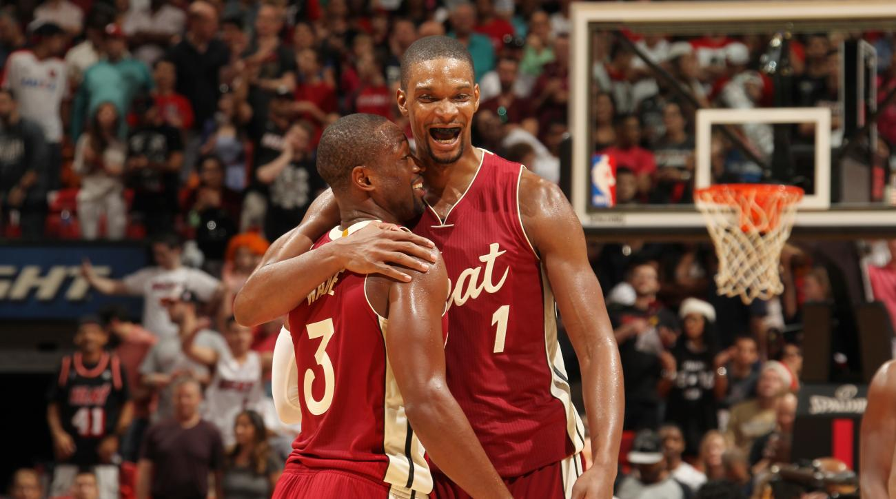 MIAMI, FL - DECEMBER 25:  Chris Bosh #1 of the Miami Heat and Dwyane Wade #3 of the Miami Heat celebrate during the game against the New Orleans Pelicans on December 25, 2015 at American Airlines Arena in Miami, Florida. (Photo by Issac Baldizon/NBAE via