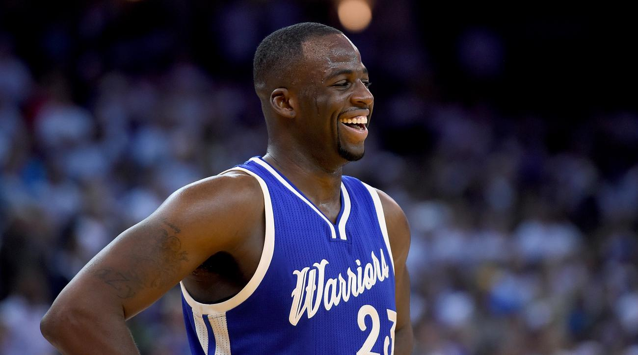 OAKLAND, CA - DECEMBER 25:  Draymond Green #23 of the Golden State Warriors looks on smiling against Cleveland Cavaliers during their NBA basketball game at ORACLE Arena on December 25, 2015 in Oakland, California. (Photo by Thearon W. Henderson/Getty Ima
