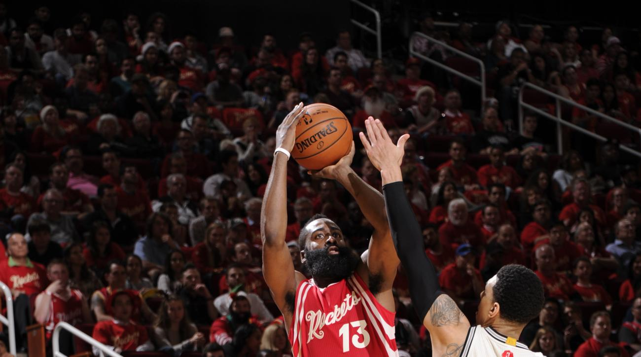 HOUSTON, TX - DECEMBER 25:  James Harden #13 of the Houston Rockets Shoots the ball against the San Antonio Spurs on December 25, 2015 at Toyota Center in Houston,Texas.(Photo by Bill Baptist/NBAE via Getty Images)