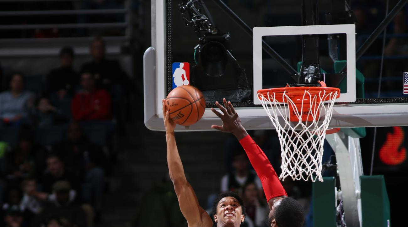 BROOKLYN, NY - DECEMBER 26: Rashad Vaughn #20 of the Milwaukee Bucks hooks the ball against the Toronto Raptors during the game on December 26, 2015 at Barclays Center in Brooklyn, New York. (Photo by Nathaniel S. Butler/NBAE via Getty Images