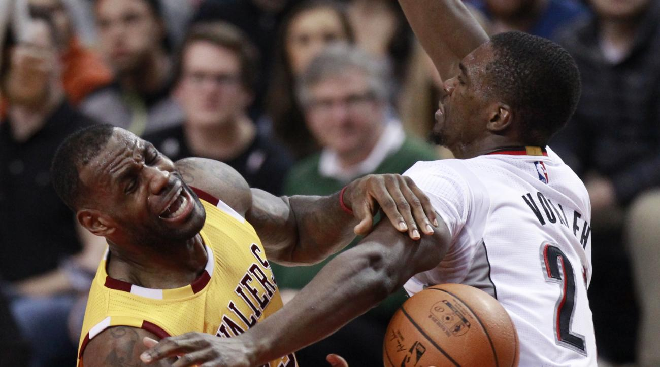 Portland Trail Blazers forward Noah Vonleh, right, knocks the ball away from Cleveland Cavaliers forward LeBron James during the second half of an NBA basketball game in Portland, Ore., Saturday, Dec. 26, 2015. (AP Photo/Steve Dipaola)