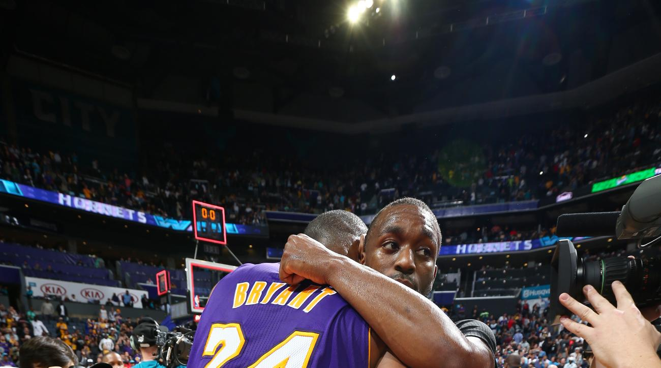 CHARLOTTE, NC - DECEMBER 28: Kobe Bryant #24 of the Los Angeles Lakers shares a hug with Kemba Walker #15 of the Charlotte Hornets after the game on December 28, 2015 at Time Warner Cable Arena in Charlotte, North Carolina. (Photo by Nat Butler/NBAE via G