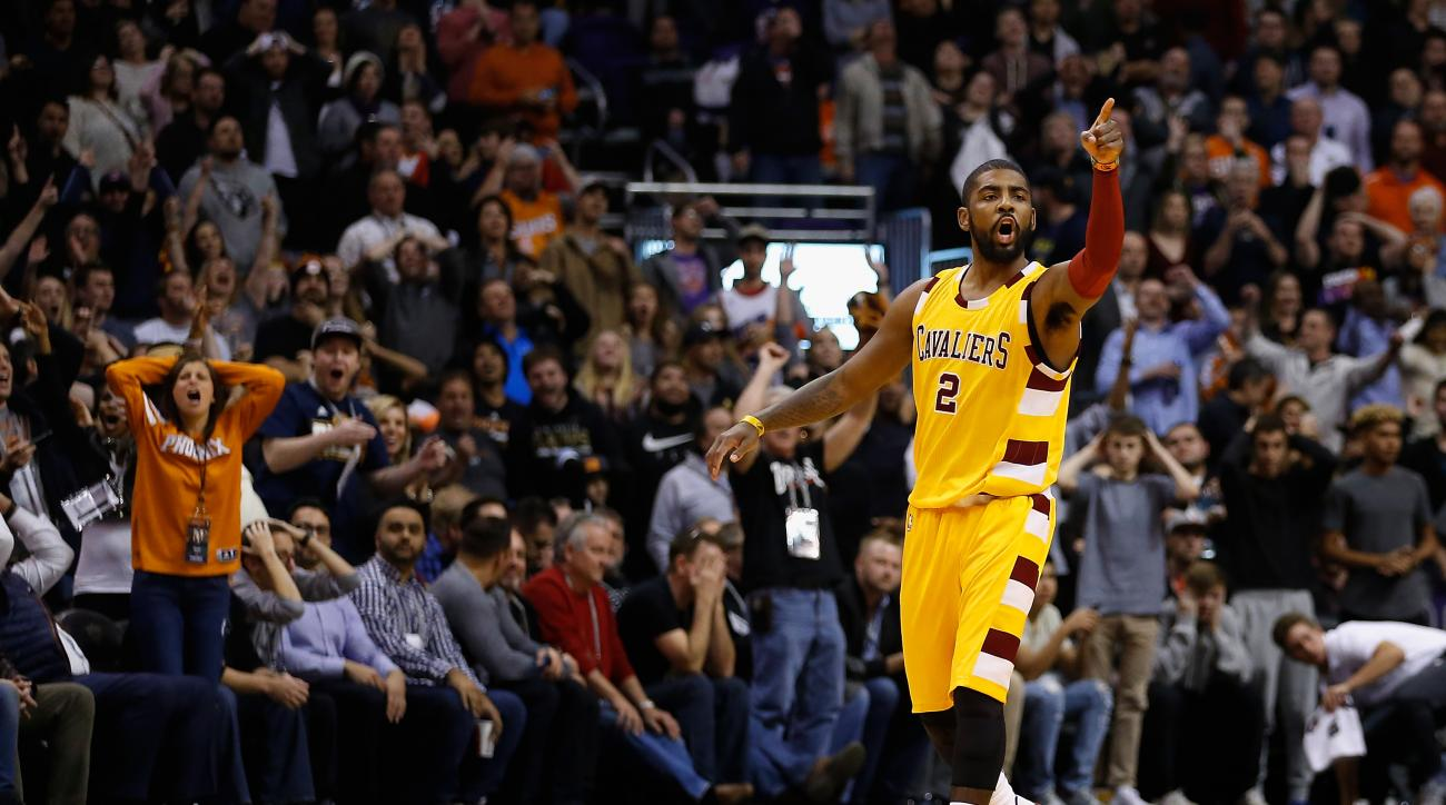 PHOENIX, AZ - DECEMBER 28:  Kyrie Irving #2 of the Cleveland Cavaliers points to the bench after hitting a three point shot against the Phoenix Suns during the final moments of the NBA game at Talking Stick Resort Arena on December 28, 2015 in Phoenix, Ar