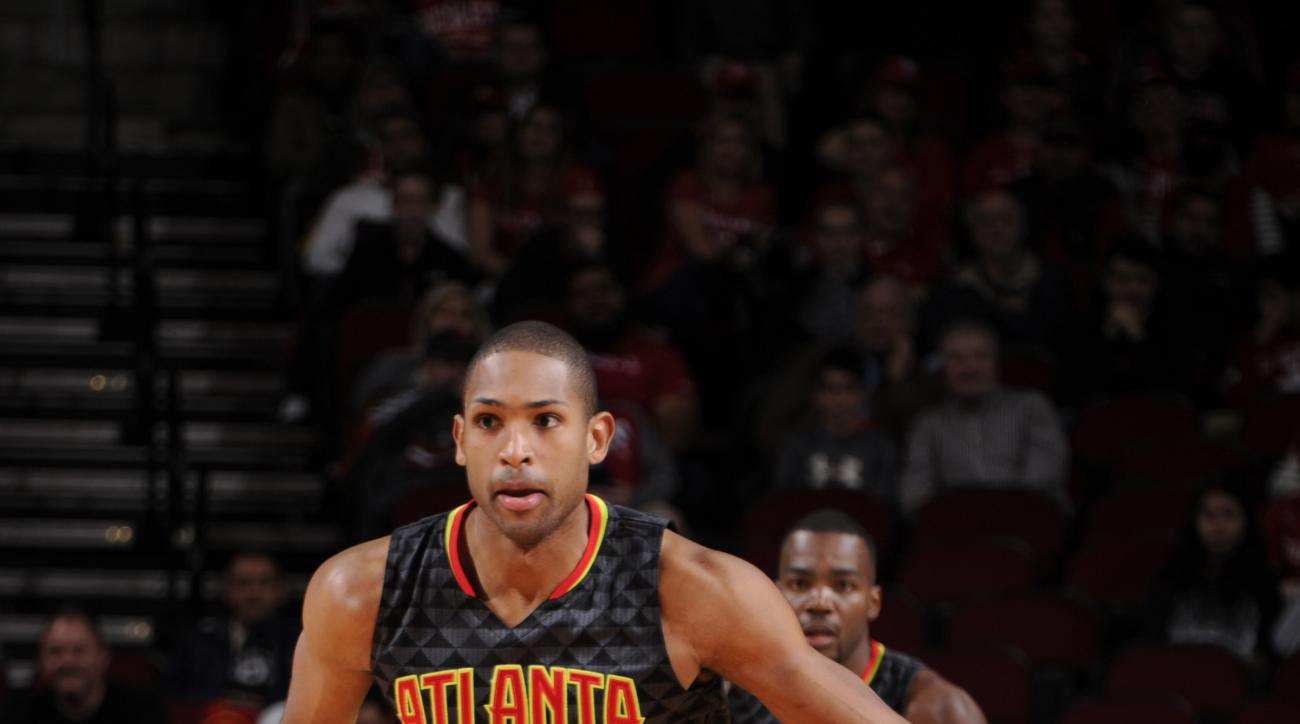 HOUSTON, TX - DECEMBER 29:  Al Horford #15 of the Atlanta Hawks handles the ball against the Houston Rockets on December 29, 2015 at the Toyota Center in Houston, Texas. (Photo by Bill Baptist/NBAE via Getty Images)
