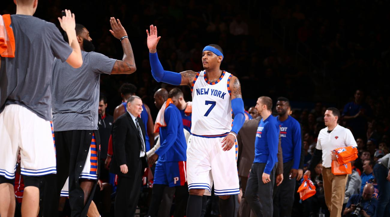 NEW YORK, NY - DECEMBER 29:  Carmelo Anthony #7 of the New York Knicks shakes hands with his teammates during the game against the Detroit Pistons on December 29, 2015 at Madison Square Garden in New York City, New York.  (Photo by Nathaniel S. Butler/NBA
