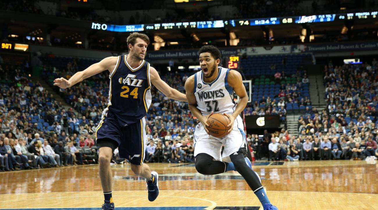 MINNEAPOLIS, MN -  DECEMBER 30:  Karl-Anthony Towns #32 of the Minnesota Timberwolves drives to the basket against Jeff Withey #24 of the Utah Jazz on December 30, 2015 at Target Center in Minneapolis, Minnesota. (Photo by Jordan Johnson/NBAE via Getty Im