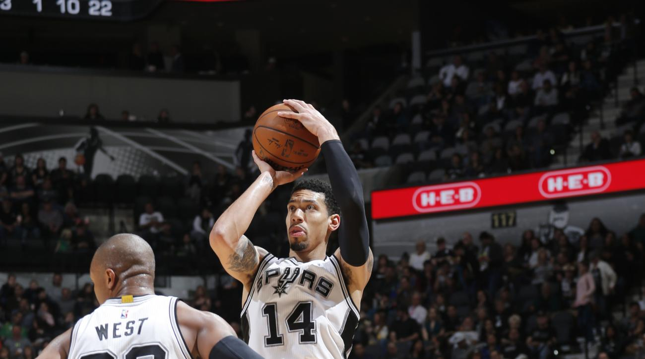 SAN ANTONIO, TX - DECEMBER 30: Danny Green #14 of the San Antonio Spurs shoots the ball during the game against the Phoenix Suns on December 30, 2015 at the AT&T Center in San Antonio, Texas.