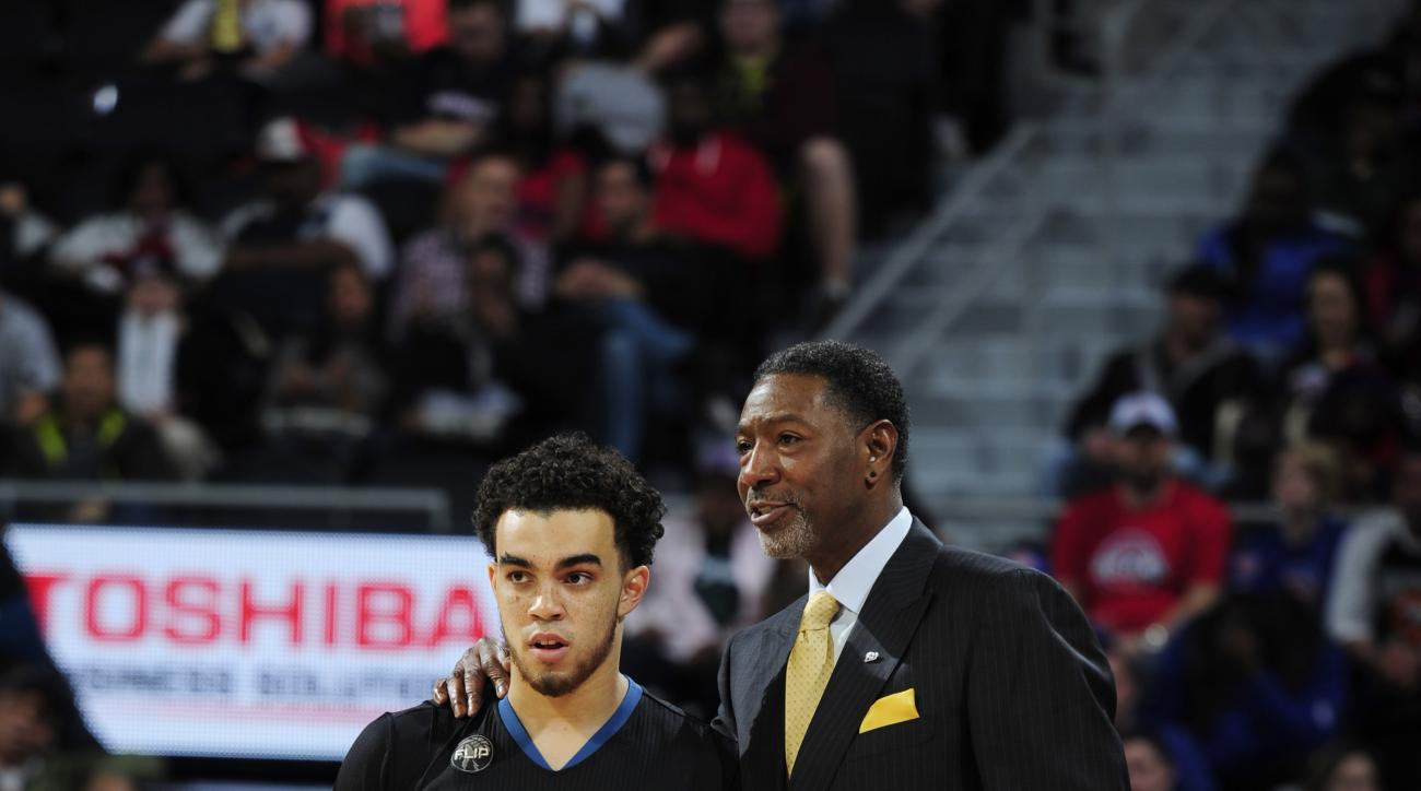 AUBURN HILLS, MI - DECEMBER 31:  Head Coach Sam Mitchell of the Minnesota Timberwolves talks with Tyus Jones #1 during the game against the Detroit Pistons on December 31, 2015 at The Palace of Auburn Hills in Auburn Hills, Michigan. (Photo by Allen Einst