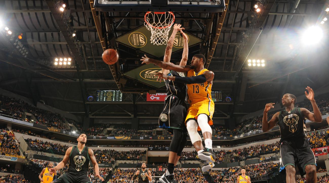 INDIANAPOLIS, IN - DECEMBER 31: Paul George #13 of the Indiana Pacers passes the ball against the Milwaukee Bucks on December 31, 2015 at Bankers Life Fieldhouse in Indianapolis, Indiana. (Photo by Ron Hoskins/NBAE via Getty Images)