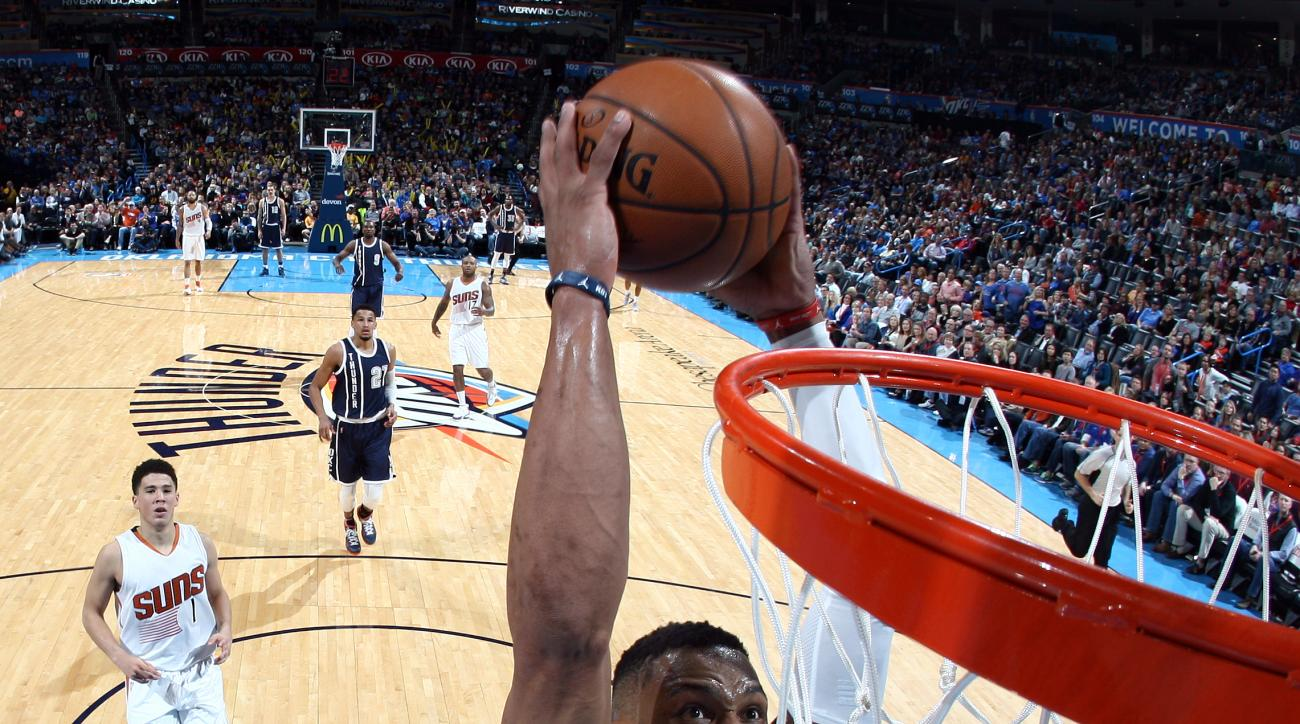 OKLAHOMA CITY, OK - DECEMBER 31:  Russell Westbrook #0 of the Oklahoma City Thunder goes to the basket against the Phoenix Suns on December 31, 2015 at Chesapeake Energy Arena in Oklahoma City, Oklahoma. (Photo by Layne Murdoch/NBAE via Getty Images)