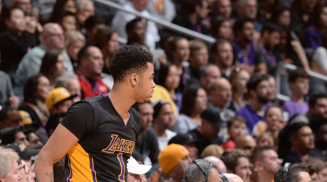 LOS ANGELES, CA - JANUARY 1:  D'Angelo Russell #1 of the Los Angeles Lakers and Jahlil Okafor #8 of the Philadelphia 76ers talk during the game on January 1, 2016 at STAPLES Center in Los Angeles, California. (Photo by Andrew D. Bernstein/NBAE via Getty I