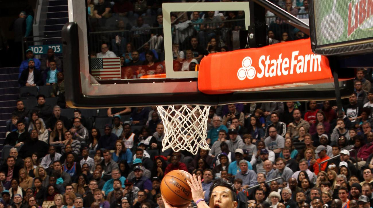 CHARLOTTE, NC - JANUARY 2: Jeremy Lin #7 of the Charlotte Hornets goes for the lay up during the game against the Oklahoma City Thunder on January 2, 2016 at Time Warner Cable Arena in Charlotte, North Carolina. (Photo by Kent Smith/NBAE via Getty Images)