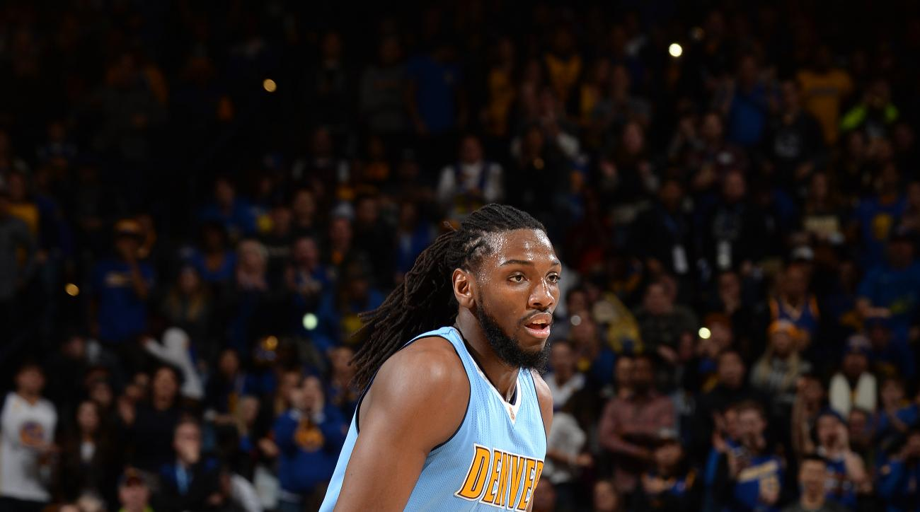 OAKLAND, CA - JANUARY 2: Kenneth Faried #35 of the Denver Nuggets handles the ball during the game against the Golden State Warriors on January 2, 2016 at ORACLE Arena in Oakland, California. (Photo by Noah Graham/NBAE via Getty Images)