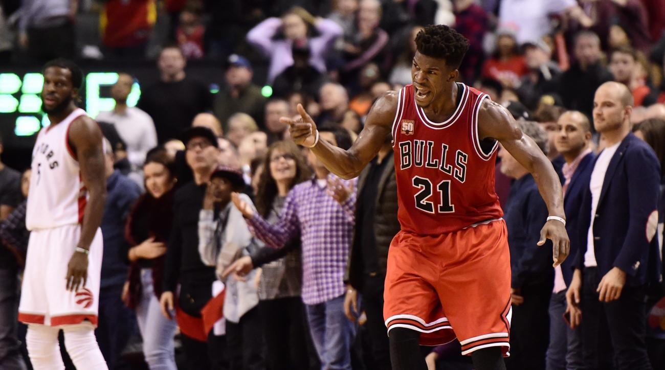 Chicago Bulls' Jimmy Butler celebrates a three-point basket against the Toronto Raptors during second half NBA basketball action in Toronto on Sunday, Jan. 3, 2016. (Frank Gunn/The Canadian Press via AP)