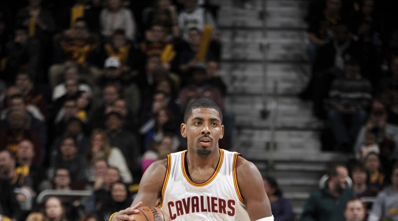 CLEVELAND, OH - JANUARY 4:  Kyrie Irving #2 of the Cleveland Cavaliers brings the ball up court against the Toronto Raptors on January 4, 2016 at Quicken Loans Arena in Cleveland, Ohio. (Photo by David Liam Kyle/NBAE via Getty Images)