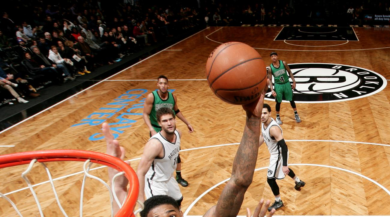 BROOKLYN, NY - JANUARY 4: Jae Crowder #99 of the Boston Celtics shoots the ball against the Brooklyn Nets on January 4, 2016 at Barclays Center in Brooklyn, New York. (Photo by Nathaniel S. Butler/NBAE via Getty Images)