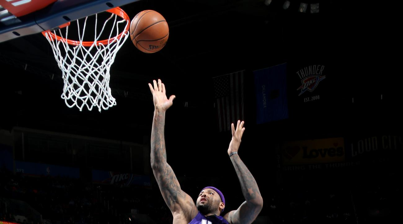OKLAHOMA CITY, OK- JANUARY 4: DeMarcus Cousins #15 of the Sacramento Kings shoots the ball during the game against the Oklahoma City Thunder on January 4, 2016 at Chesapeake Energy Arena in Oklahoma City, Oklahoma. (Photo by Layne Murdoch/NBAE via Getty I