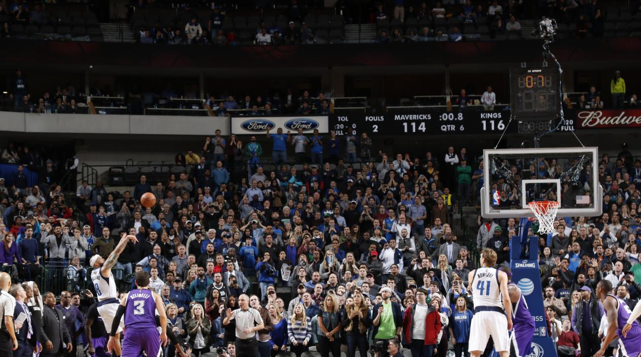 DALLAS, TX - JANUARY 5: Deron Williams #8 of the Dallas Mavericks knocks down the game-winning three pointer at the buzzer during a double-overtime win against the Sacramento Kings on January 5, 2016 at the American Airlines Center in Dallas, Texas. (Phot