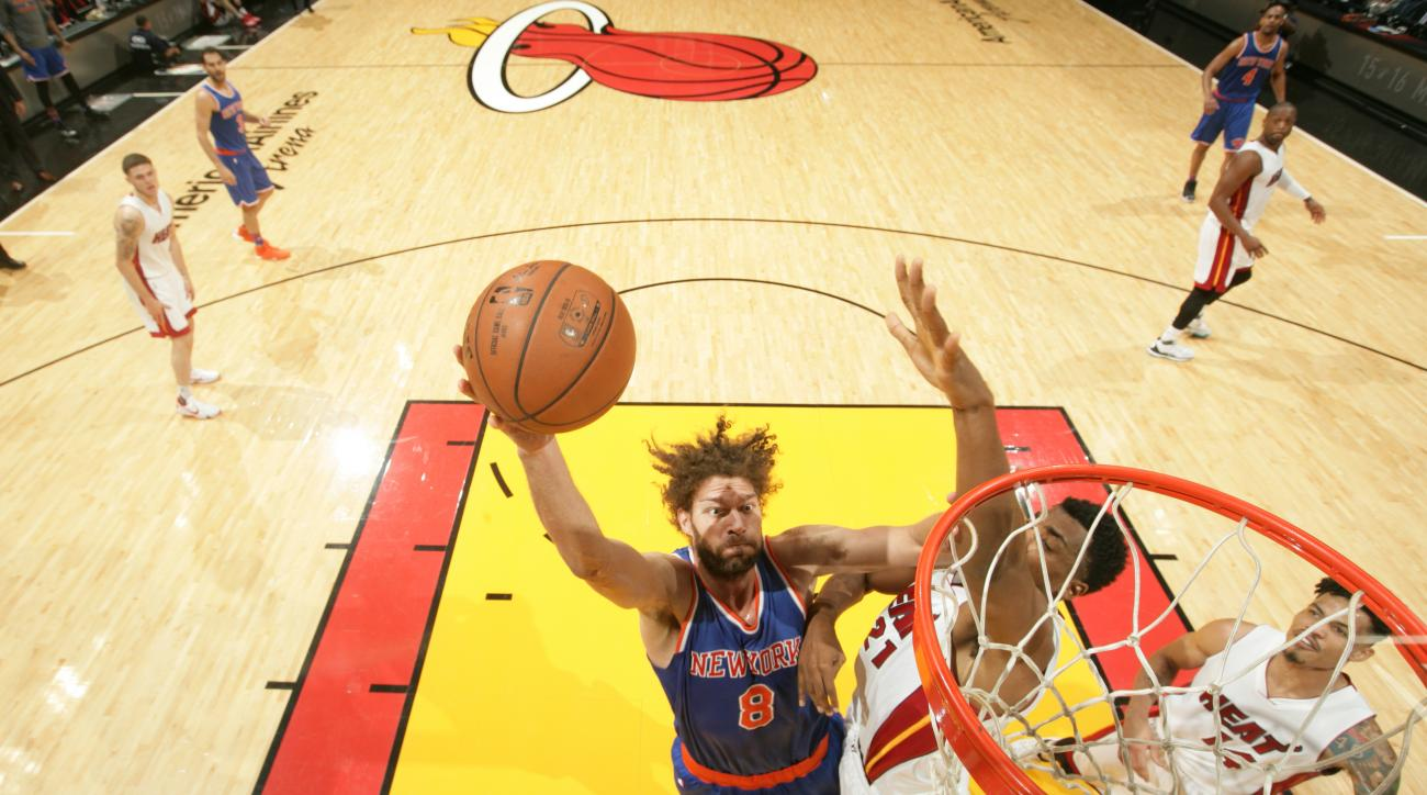 MIAMI, FL - JANUARY 6:  Robin Lopez #8 of the New York Knicks shoots the ball against the Miami Heat on January 6, 2016 at American Airlines Arena in Miami, Florida. (Photo by Issac Baldizon/NBAE via Getty Images)
