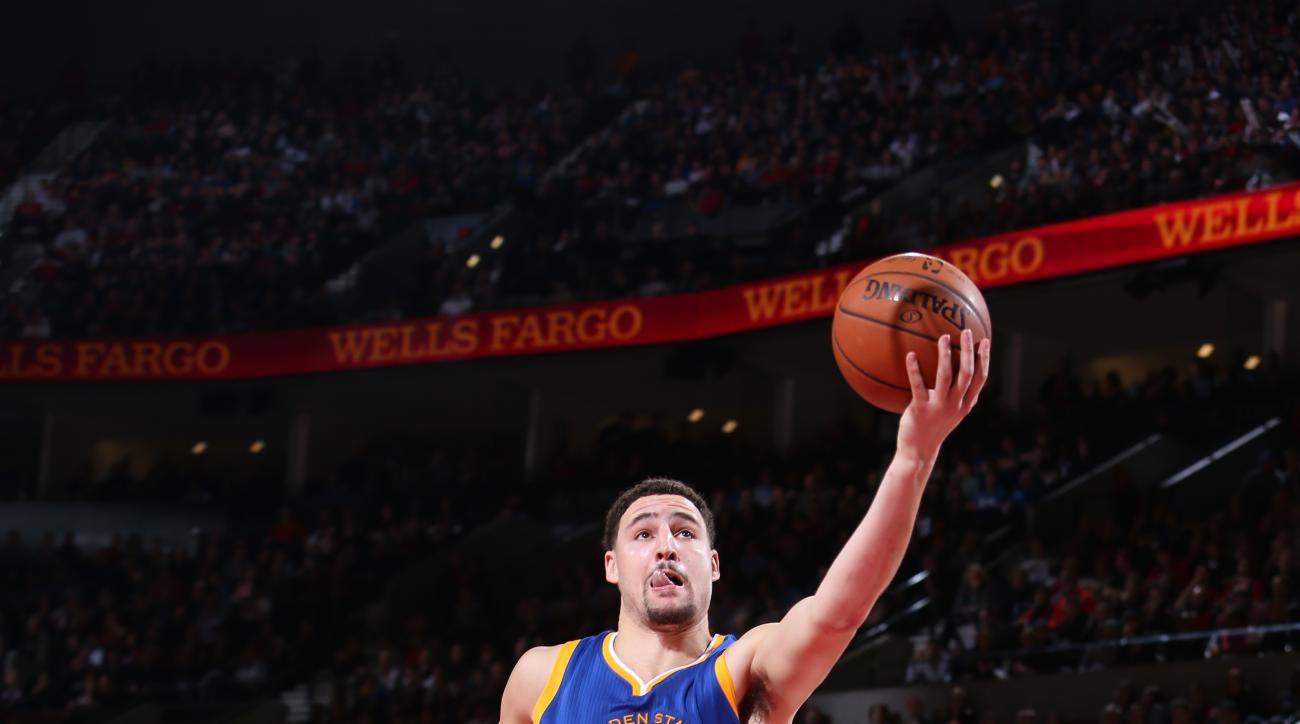 PORTLAND, OR - JANUARY 8: Klay Thompson #11 of the Golden State Warriors shoots the ball against the Portland Trail Blazers on January 8, 2016 at the Moda Center in Portland, Oregon. (Photo by Sam Forencich/NBAE via Getty Images)