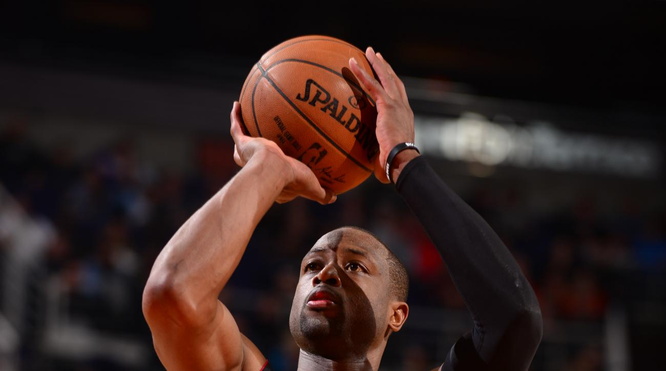 PHOENIX, AZ - JANUARY 8:  Dwyane Wade #3 of the Miami Heat shoots a free throw against the Phoenix Suns on January 8, 2016 at Talking Stick Resort Arena in Phoenix, Arizona. (Photo by Barry Gossage/NBAE via Getty Images)