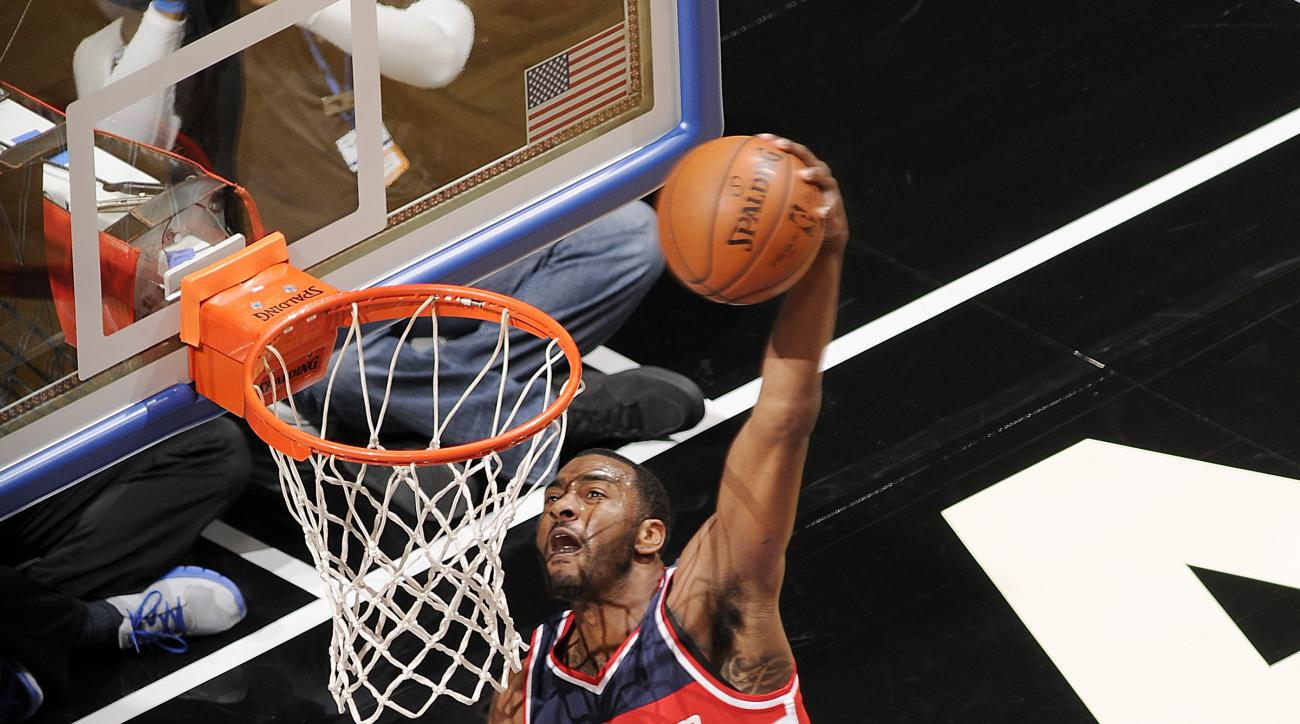 ORLANDO, FL - JANUARY 9:  John Wall #2 of the Washington Wizards goes up for a dunk against the Orlando Magic on January 9, 2016 at Amway Center in Orlando, Florida. (Photo by Fernando Medina/NBAE via Getty Images)