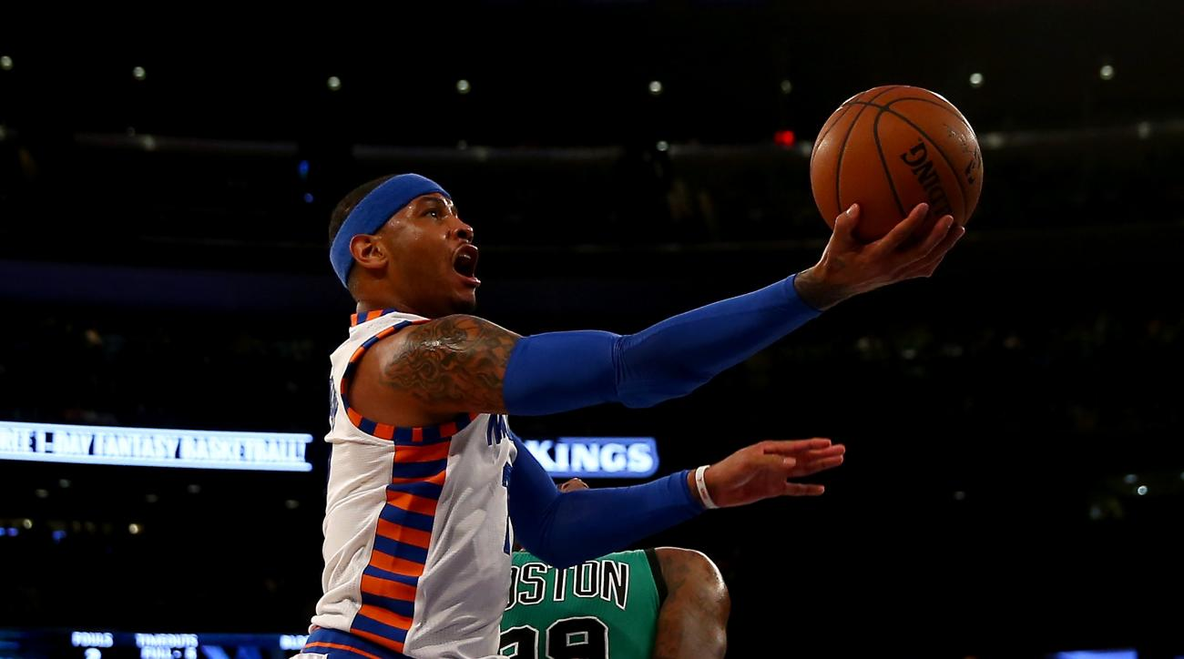 NEW YORK, NY - JANUARY 12:  Carmelo Anthony #7 of the New York Knicks heads for the net as Jae Crowder #99 of the Boston Celtics defends at Madison Square Garden on January 12, 2016 in New York City. (Photo by Elsa/Getty Images)