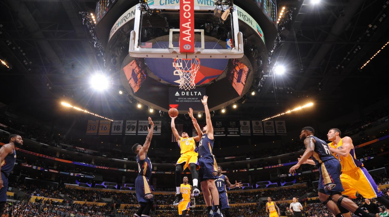 LOS ANGELES, CA - JANUARY 12:  Jordan Clarkson #6 of the Los Angeles Lakers goes to the basket against Ryan Anderson #33 of the New Orleans Pelicans on January 12, 2016 at STAPLES Center in Los Angeles, California. (Photo by Andrew D. Bernstein/NBAE via G