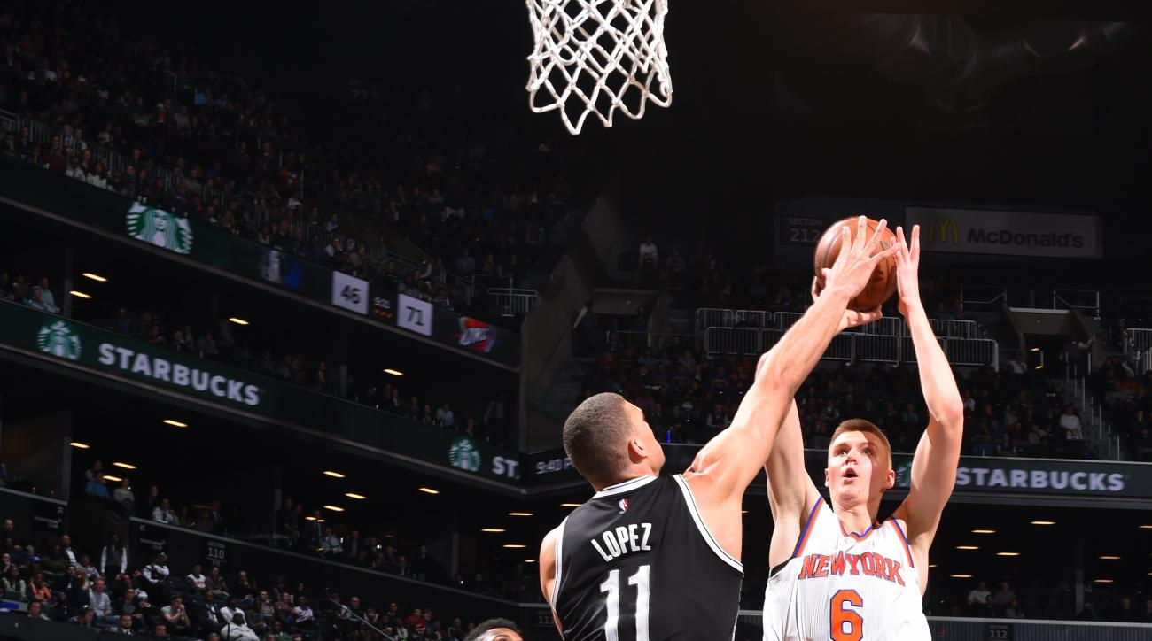 BROOKLYN, NY - JANUARY 13:  Kristaps Porzingis #6 of the New York Knicks shoots the ball against the Brooklyn Nets on January 13, 2015 at Barclays Center in Brooklyn, New York. (Photo by Jesse D. Garrabrant/NBAE via Getty Images)