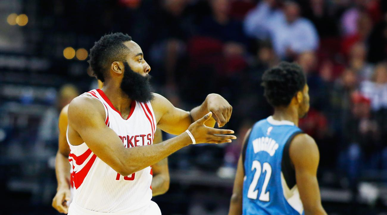 HOUSTON, TX - JANUARY 13:  James Harden #13 of the Houston Rockets celebrates a three-point shot on the court during their game against the Minnesota Timberwolves at the Toyota Center on January 13, 2016  in Houston, Texas. (Photo by Scott Halleran/Getty
