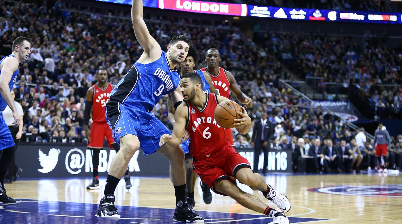 LONDON, ENGLAND - JANUARY 14:  Cory Joseph #6 of the Toronto Raptors handles the ball against Nikola Vucevic #9 of the Orlando Magic as part of the 2016 Global Games London on January 14, 2016 at The O2 Arena in London, England. (Photo by Nathaniel S. But