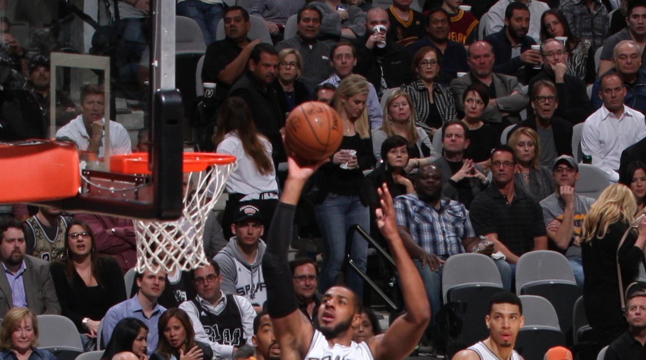 SAN ANTONIO, TX - JANUARY 14:  LaMarcus Aldridge #12 of the San Antonio Spurs shoots the ball against the Cleveland Cavalierson January 14, 2016 at the AT&T Center in San Antonio, Texas.