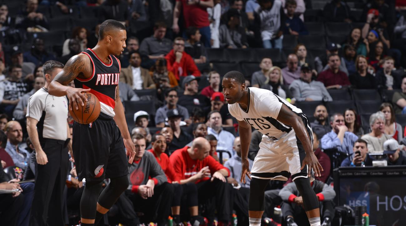 BROOKLYN, NY - JANUARY 15 :  Damian Lillard #0 of the Portland Trail Blazers controls the ball against the Brooklyn Nets on January 15, 2015 at Barclays Center in Brooklyn, New York. (Photo by David Dow/NBAE via Getty Images)