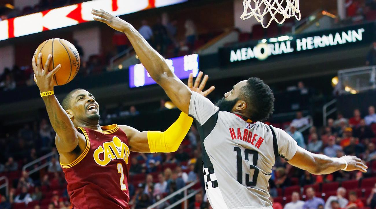 HOUSTON, TX - JANUARY 15:  Kyrie Irving #2 of the Cleveland Cavaliers drives with the ball against James Harden #13 of the Houston Rockets during their game at the Toyota Center on January 15, 2016  in Houston, Texas. (Photo by Scott Halleran/Getty Images