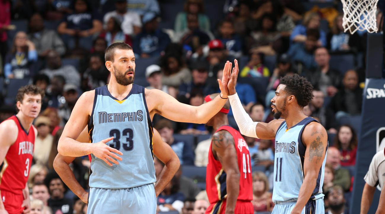 MEMPHIS, TN - JANUARY 18: Marc Gasol #33 of the Memphis Grizzlies celebrates with Mike Conley #11 of the Memphis Grizzlies during the game against the New Orleans Pelicans on January 18, 2016 in Memphis, Tennessee. (Photo by Joe Murphy/NBAE via Getty Imag