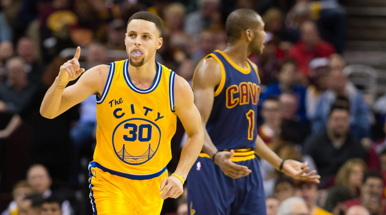 CLEVELAND, OH - JANUARY 18: Stephen Curry #30 of the Golden State Warriors celebrates after scoring over James Jones #1 of the Cleveland Cavaliers during the second half at Quicken Loans Arena on January 18, 2016 in Cleveland, Ohio. The Warriors defeated