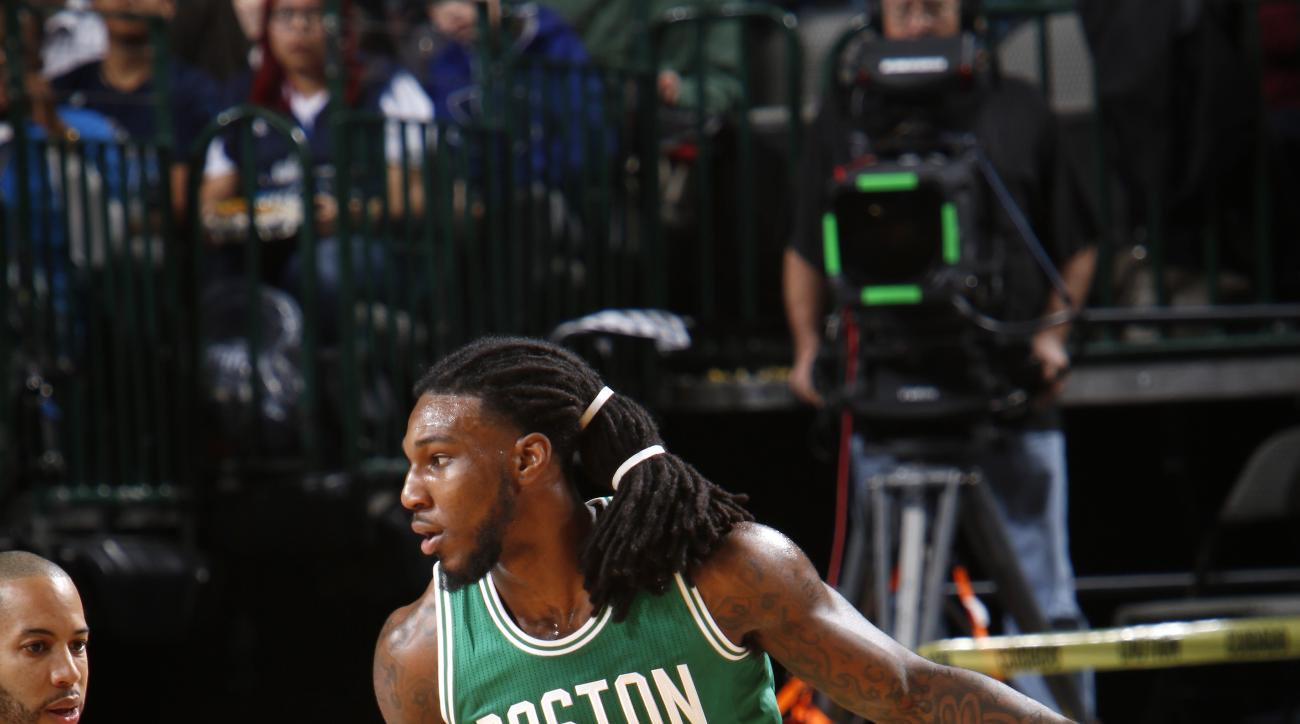 DALLAS, TX - JANUARY 18: Jae Crowder #99 of the Boston Celtics handles the ball against the Dallas Mavericks on January 18, 2016 at the American Airlines Center in Dallas, Texas. (Photo by Glenn James/NBAE via Getty Images)
