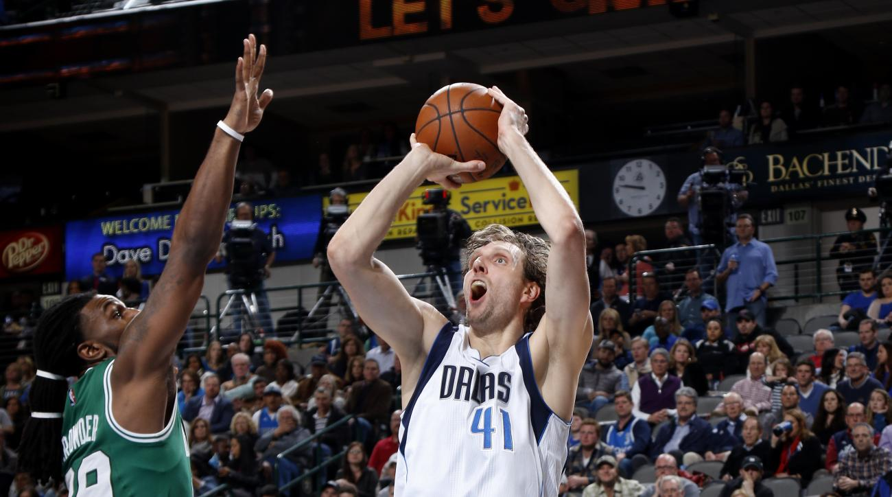 DALLAS, TX - JANUARY 18: Dirk Nowitzki #41 of the Dallas Mavericks shoots a jumper against the Boston Celtics on January 18, 2016 at the American Airlines Center in Dallas, Texas. (Photo by Glenn James/NBAE via Getty Images)