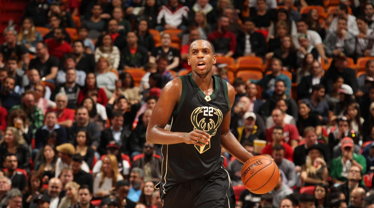 MIAMI, FL - JANUARY 19:  Khris Middleton #22 of the Milwaukee Bucks dribbles the ball against the Miami Heat on January 19, 2016 at AmericanAirlines Arena in Miami, Florida. (Photo by Issac Baldizon/NBAE via Getty Images)