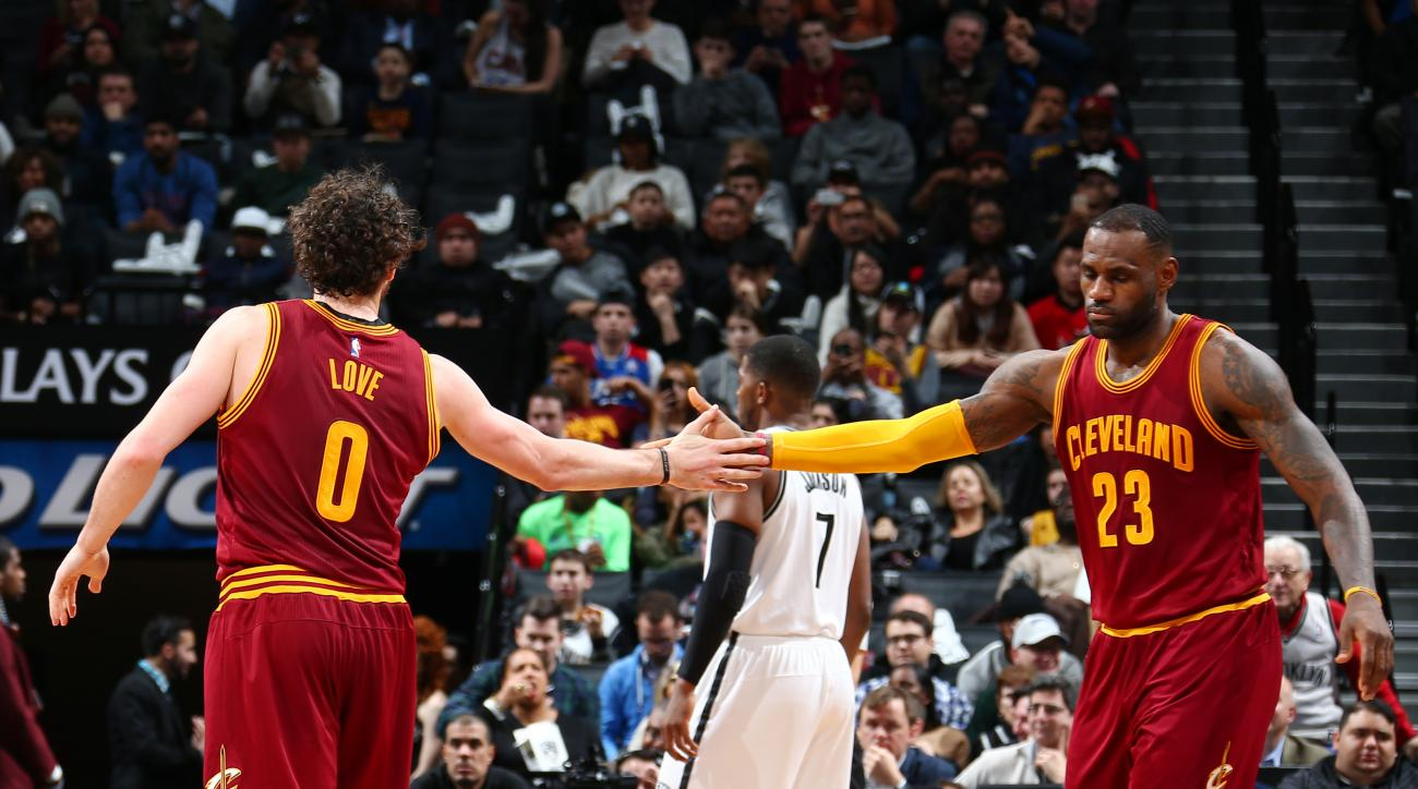 BROOKLYN, NY - JANUARY 20:  LeBron James #23 of the Cleveland Cavaliers shakes hands with Kevin Love #0 of the Cleveland Cavaliers during the game against the Brooklyn Nets on January 20, 2016 at Barclays Center in Brooklyn, New York. (Photo by Nathaniel