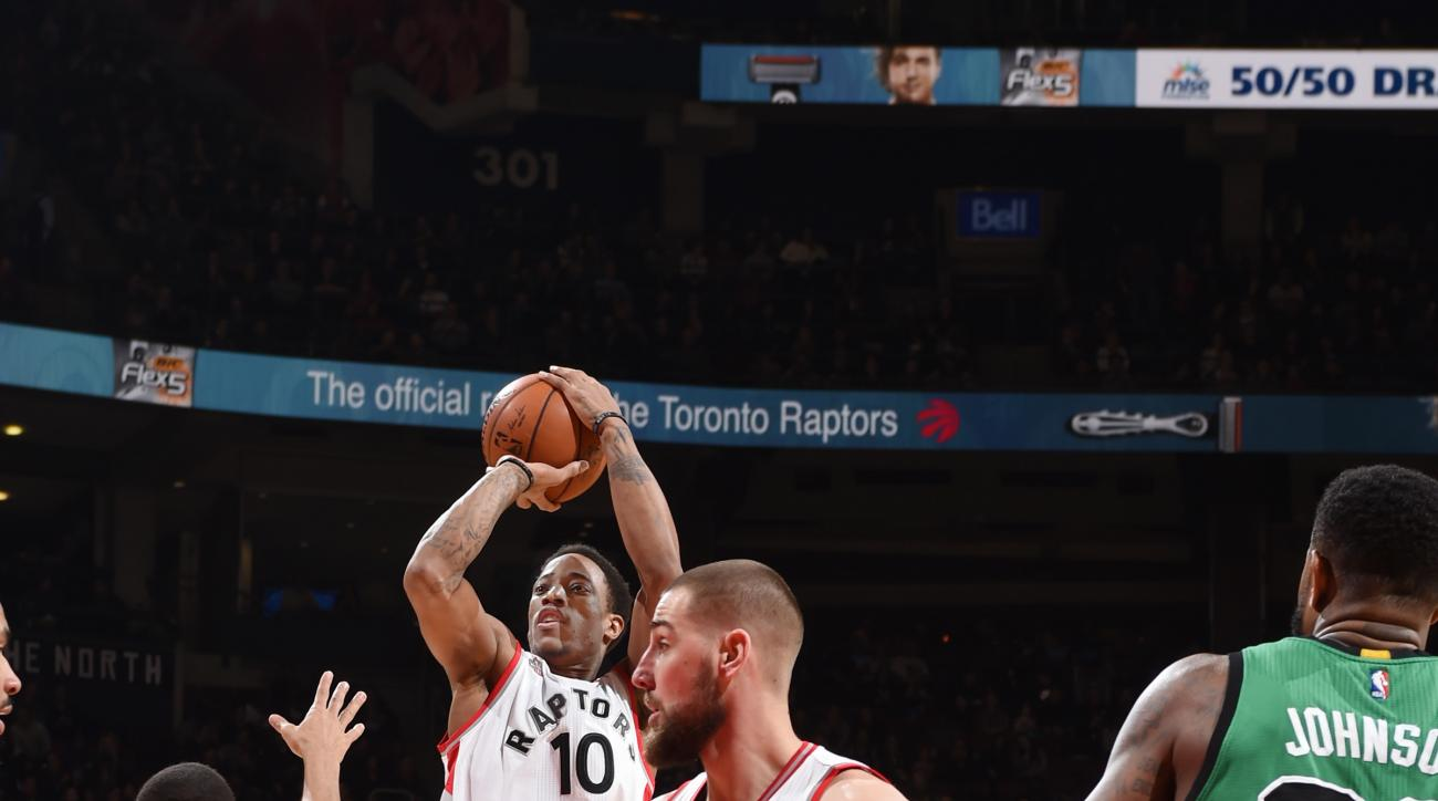 TORONTO, CANADA - JANUARY 20: DeMar DeRozan #10 of the Toronto Raptors shoots the ball against the Boston Celtics on January 20, 2016 at the Air Canada Centre in Toronto, Ontario, Canada.  (Photo by Ron Turenne/NBAE via Getty Images)