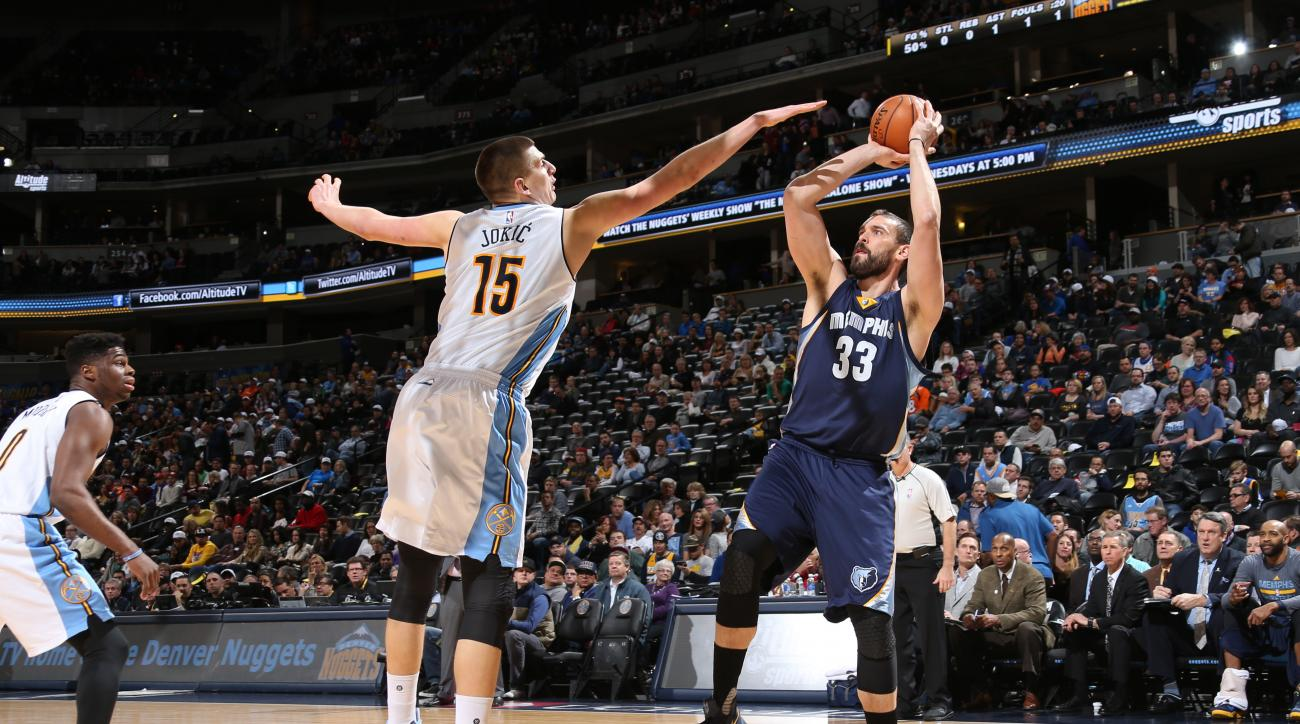DENVER, CO - JANUARY 21:  Marc Gasol #33 of the Memphis Grizzlies shoots against Nikola Jokic #15 of the Denver Nuggets on January 21, 2016 at the Pepsi Center in Denver, Colorado. (Photo by Joe Murphy/NBAE via Getty Images)