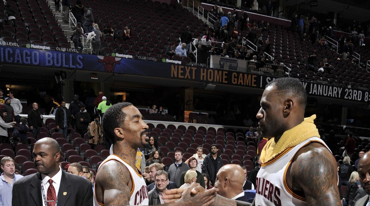 CLEVELAND, OH - JANUARY 21:  J.R. Smith #5 of the Cleveland Cavaliers and LeBron James #23 of the Cleveland Cavaliers shake hands after the game against the Los Angeles Clippers on January 21, 2016 at Quicken Loans Arena in Cleveland, Ohio. (Photo by Davi